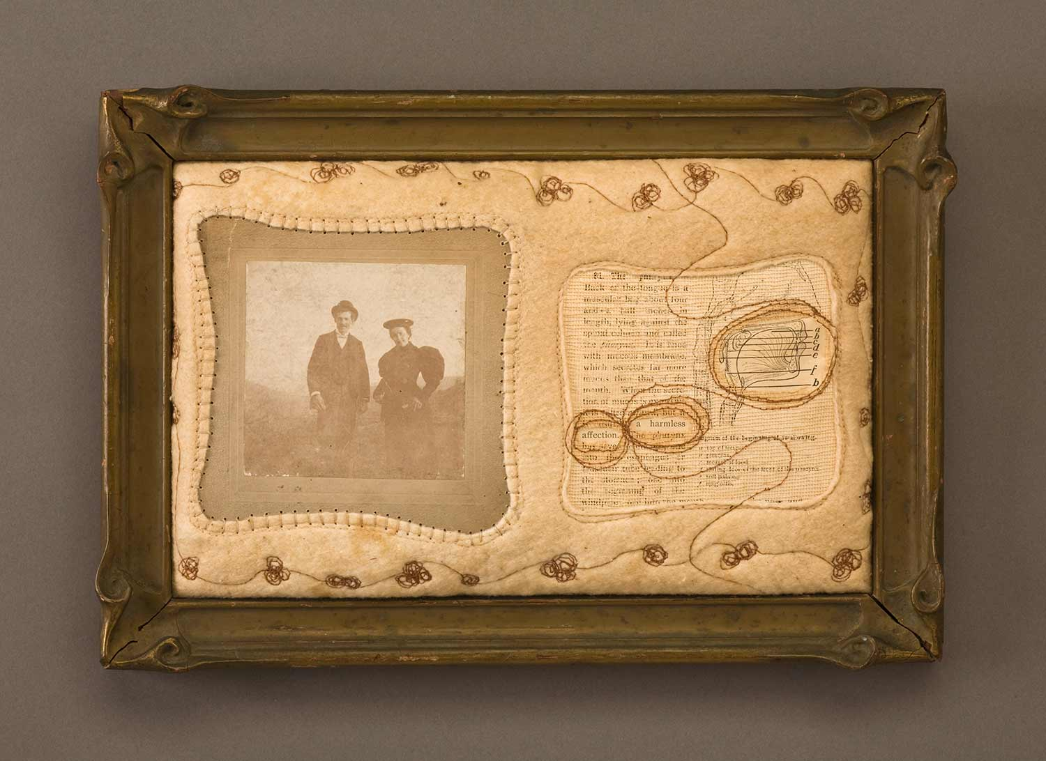 Artwork with book page, photograph, fabric, thread and frame